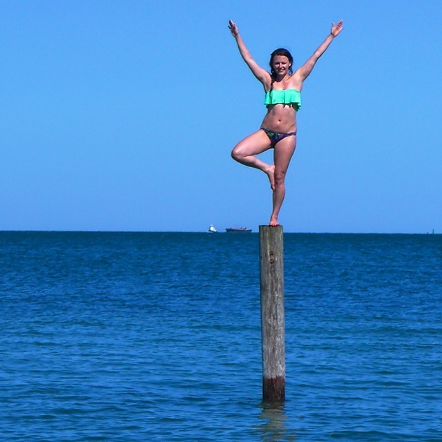 Day 2. Erin wearing the bikini top as it was meant to be worn for some good old fashioned salt water fun to take advantage of the beautiful bluebird beach day on MV #vacationmode #beachbabe #bikini #yogi #howdoigetdownfromhere