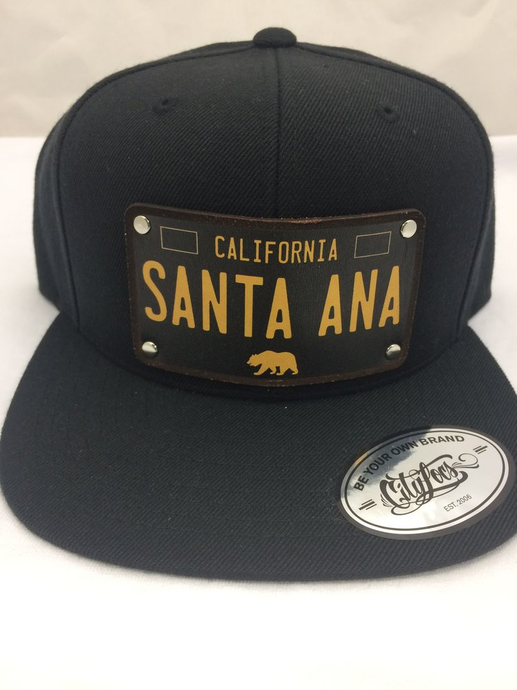 SANTA ANA LICENSE PLATE SNAPBACK HAT — Sounds of Music 896032ac45a