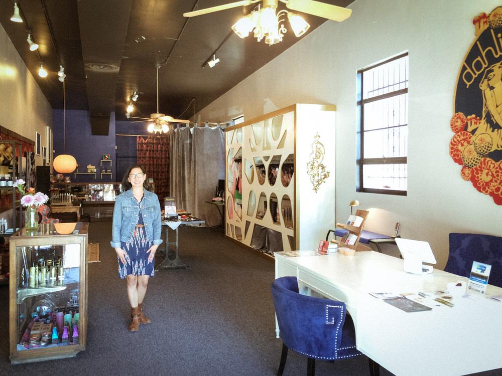 Owner Jen Fei insideher tastefulBroadway shop.