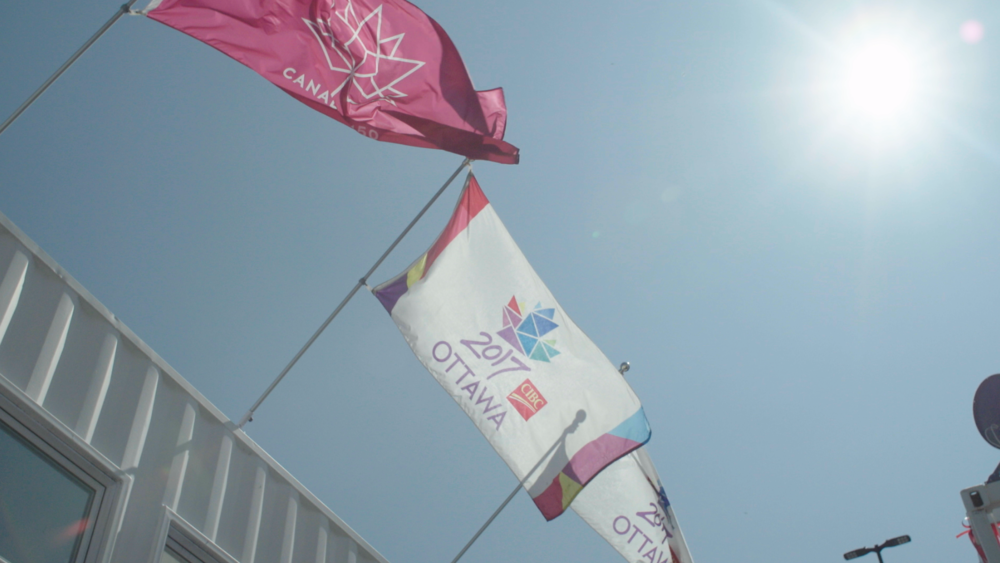 Partner Flags on top of Storygathering Booth in Ottawa Inspiration Village