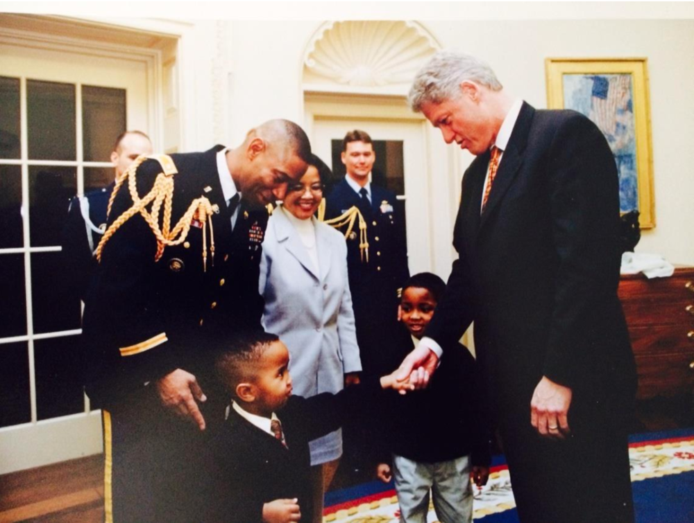 Dana Pittard and Lucille Pittard with their sons in the White House, meeting President Bill Clinton.