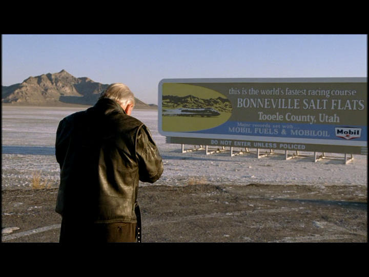Burt ( Anthony Hopkins) stands in front of a huge billboard build on the edge of the Bonneville Salt Flats.