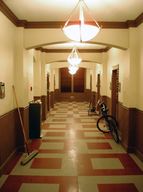 Girls boarding school dormitory hallway stage set.