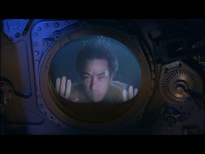 The preacher/former astronaut (David Strathairn) dreams he finds his younger self trapped in his capsule deep beneath the water. Here we draped an indoor diving pool in black, then built a water resistant capsule wall for the gag.