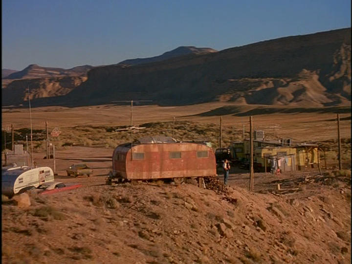 In Nobody's Baby, two hapless cons (Skeet Ulrich & Gary Oldman) escape from jail and end up rescuing a baby from a car accident, resulting in a desperate journey across a bleak and empty American southwest. Here Billy (Skeet Ulrich) confronts his new reality in this harsh and broken down trailer park we build on a remote desert plateau.