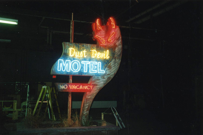 "Lit up Dust Devil Motel sign on stage for ""night"" work."