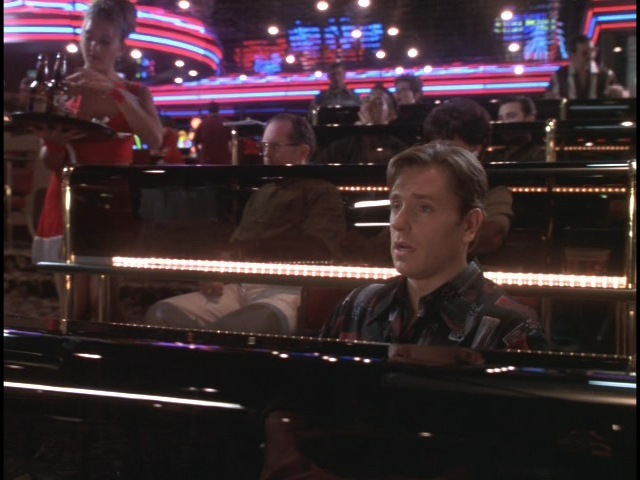 A shot of Edward (Ron Eldard) at the betting tables in our casino sports book stage set.