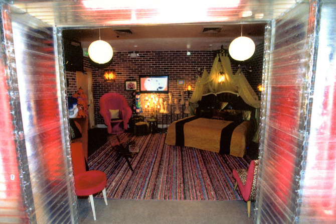 We hid the crummy plastic Chinese restaurant columns and arch inside a translucent corrugated fiberglass and steel portal with red neon inside, since one of the clients requests was a sort of a whorehouse lounge in which press interviews could be held.