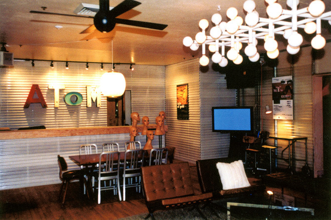 The short film distribution company Atom Films hired me to create a walk-in lounge for Sundance 1999 in a horrid mess of a Chinese Restaurant on Main Street in Park City, Utah. The request was a cool Soho loft feel on a limited budget and two days for the transformation.