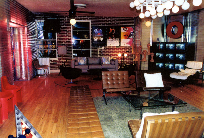 We broomed out the restaurant stuff, tore up the jade carpet, buried most of the walls behind semi-visible steel studs and white or translucent corrugated fiberglass and vacu-form brick walls, and brought in all the mid-century Scandinavian and 60's mod we could find at short notice.