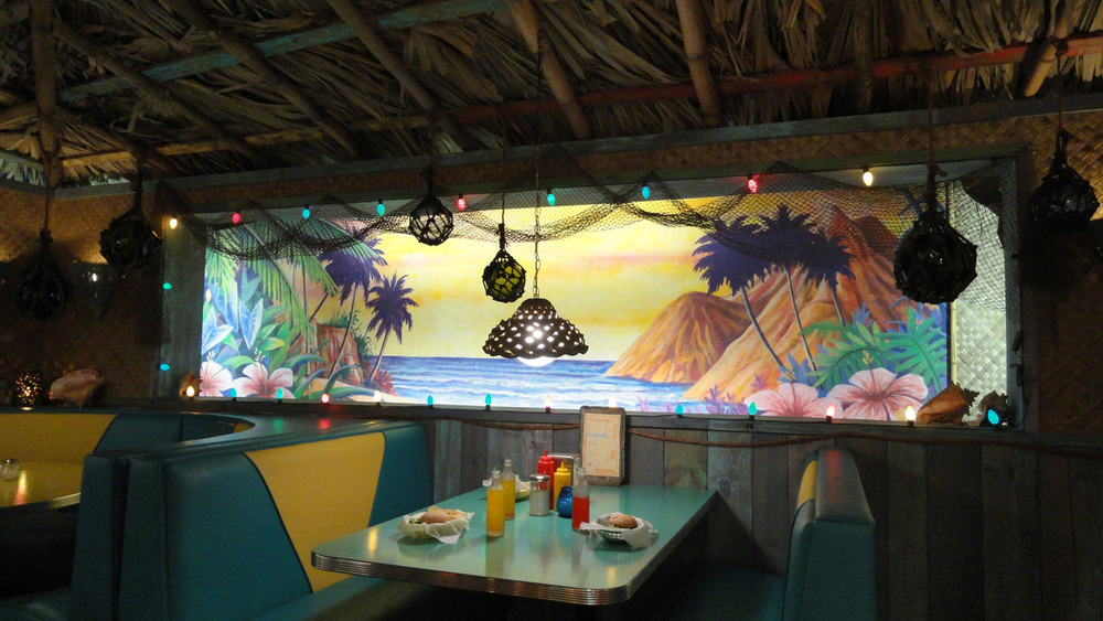 A detail shot of the booths and tropical murals in Big Momma's interior.