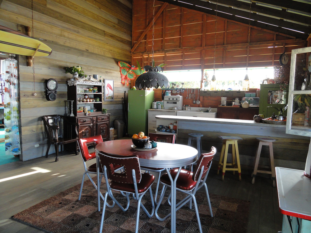 An interior shot of the breezy, open kitchen and dining room in Big Poppa's surf shop/house.