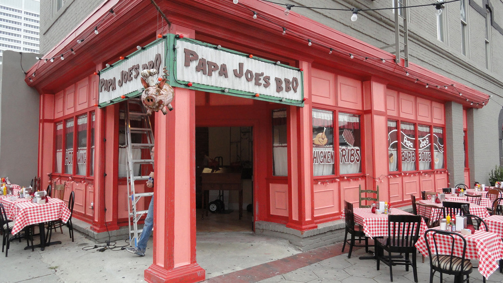 "We created ""Papa Joe's"" barbecue in an unoccupied storefront in downtown Atlanta, complete with cheerful pig/chef made out of an oil can."