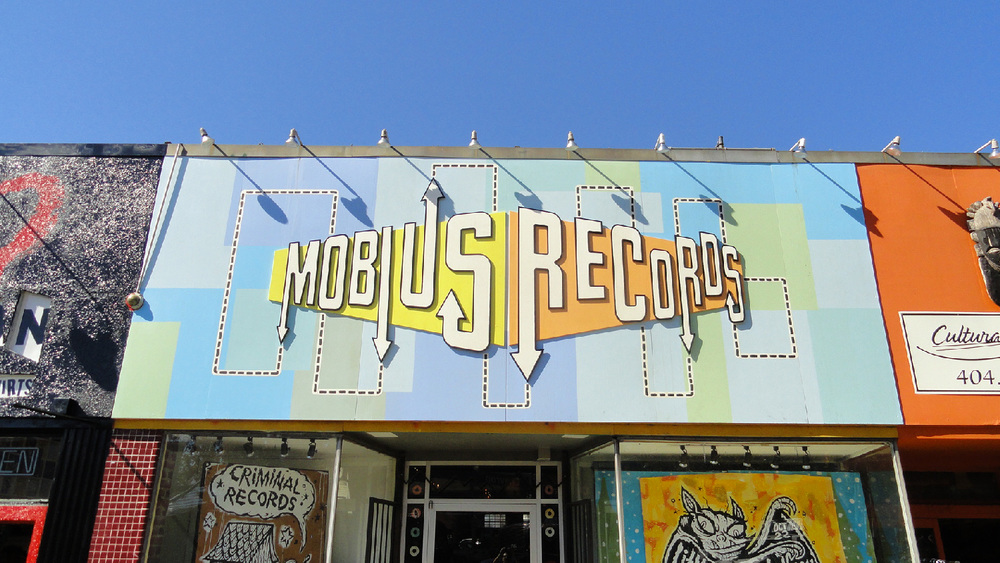 Cool fictional record shop sign we built (covering the sign for Atlanta's iconic Criminal records).