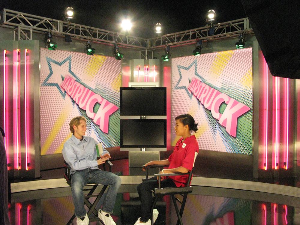 """""""Starstruck"""" TMZ-style gossip show stage set."""