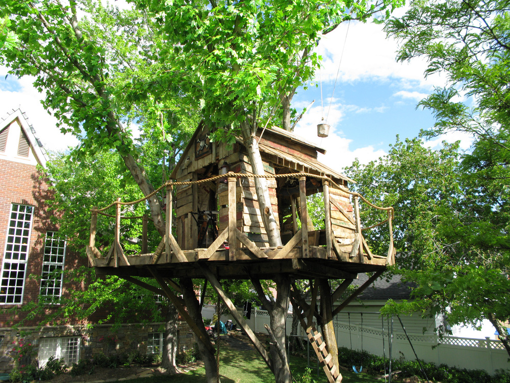 "Troy's (Zac Efron) treehouse. This house was established in two prior movies, without a tree or treehouse in the backyard. The third movie called for a size-able treehouse in the yard that had to accommodate choreography for a duet. This necessitated craning three massive trunks over the existing family home, sinking them 8 feet in the ground, then installing our tree house in them. This treehouse was later relocated to a turntable on a green screen stage for completion of the work on ""Right Here, Right Now""."