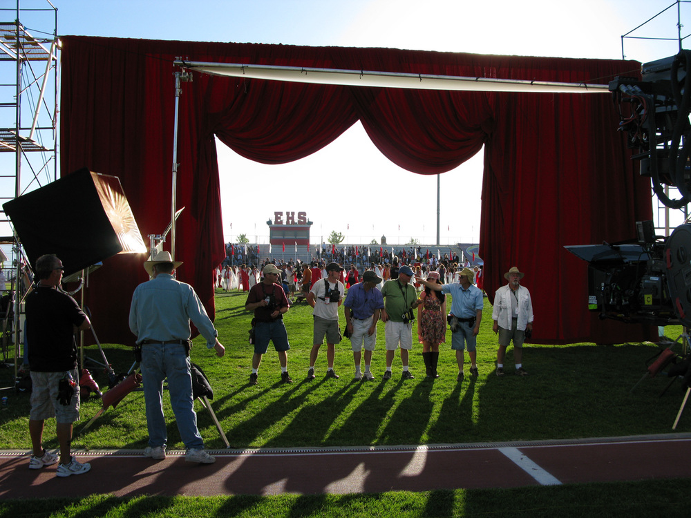 This shows a rig built for an extremely effective in-camera effect for the closing number that allowed the cast to run from graduation on the football field , have the curtain drop behind them, and with a VFX assist magically end up on the auditorium stage.
