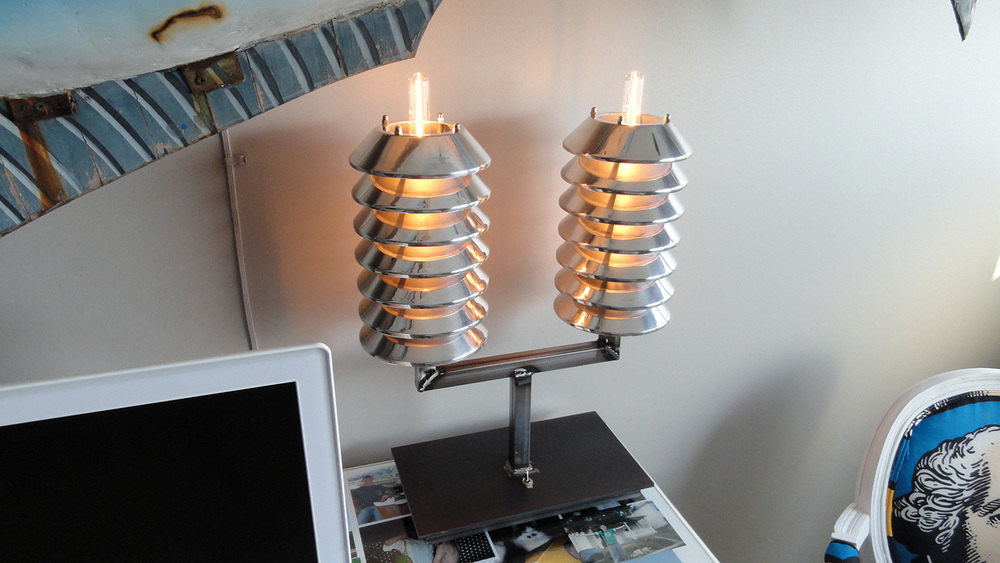 These are my Atomic Pile table lamps. The stacks are made from salvaged hygrometers (instruments for measuring moisture in soil) I bought for $15 each at a salvage place. I took them apart, had the aluminum stripped and polished, and built these steel bases for them.  This is what the hygrometers looked like before the project.