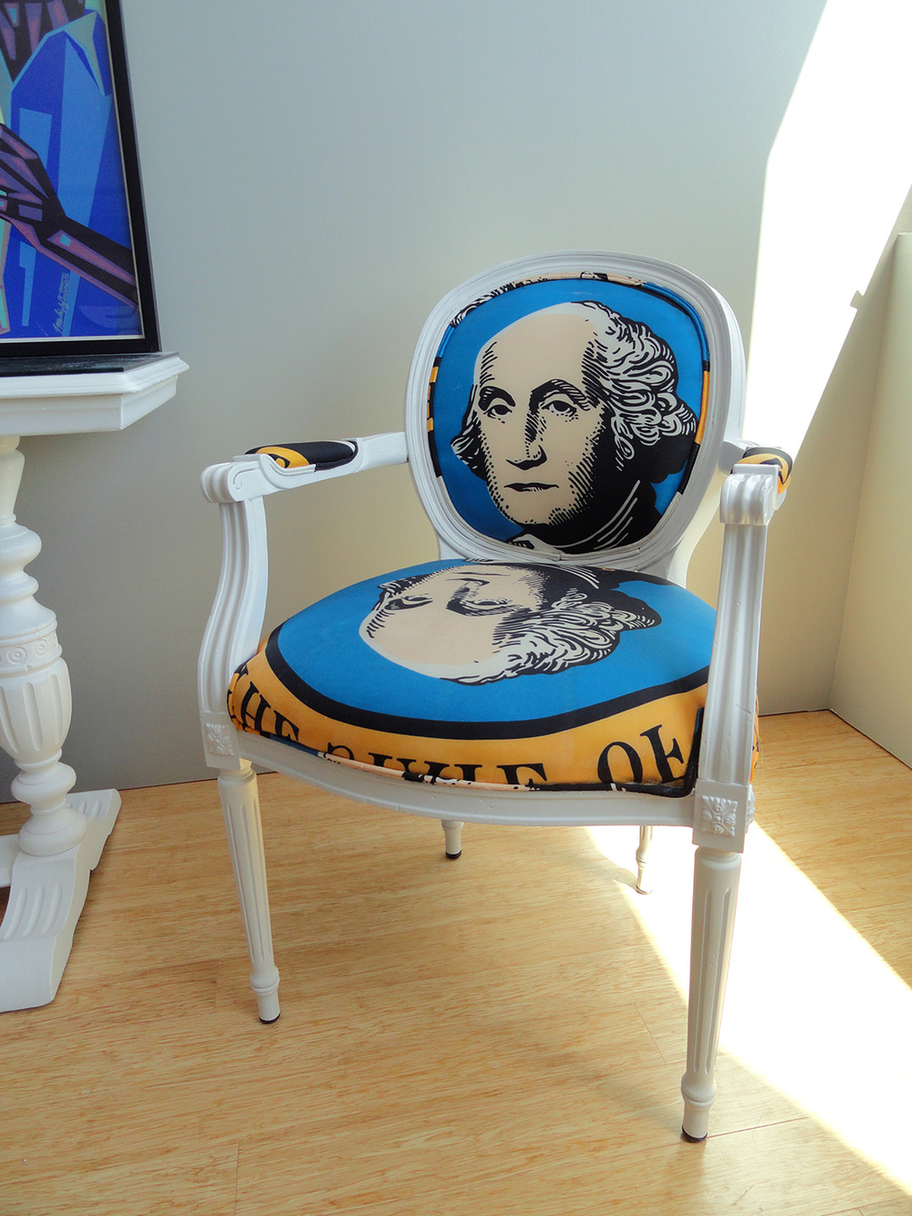 George Washington chairs, made from flea-market granny chairs reupholstered with $2 a yard Washington State nylon flags from a blemished roll.