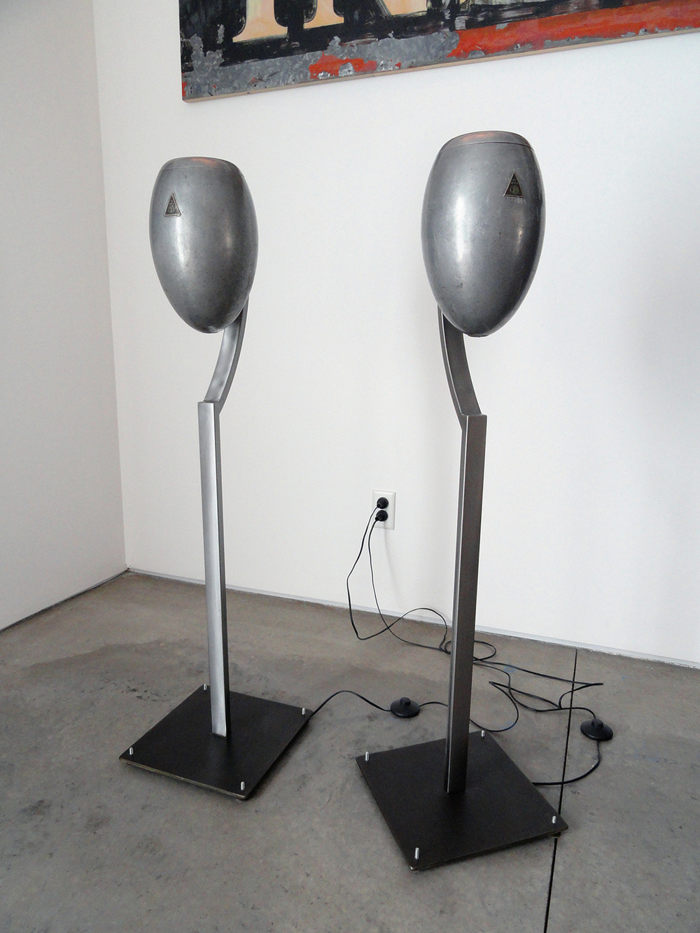 Floor lamps, made from salvaged 1920's automotive head light housings and custom steel bases.