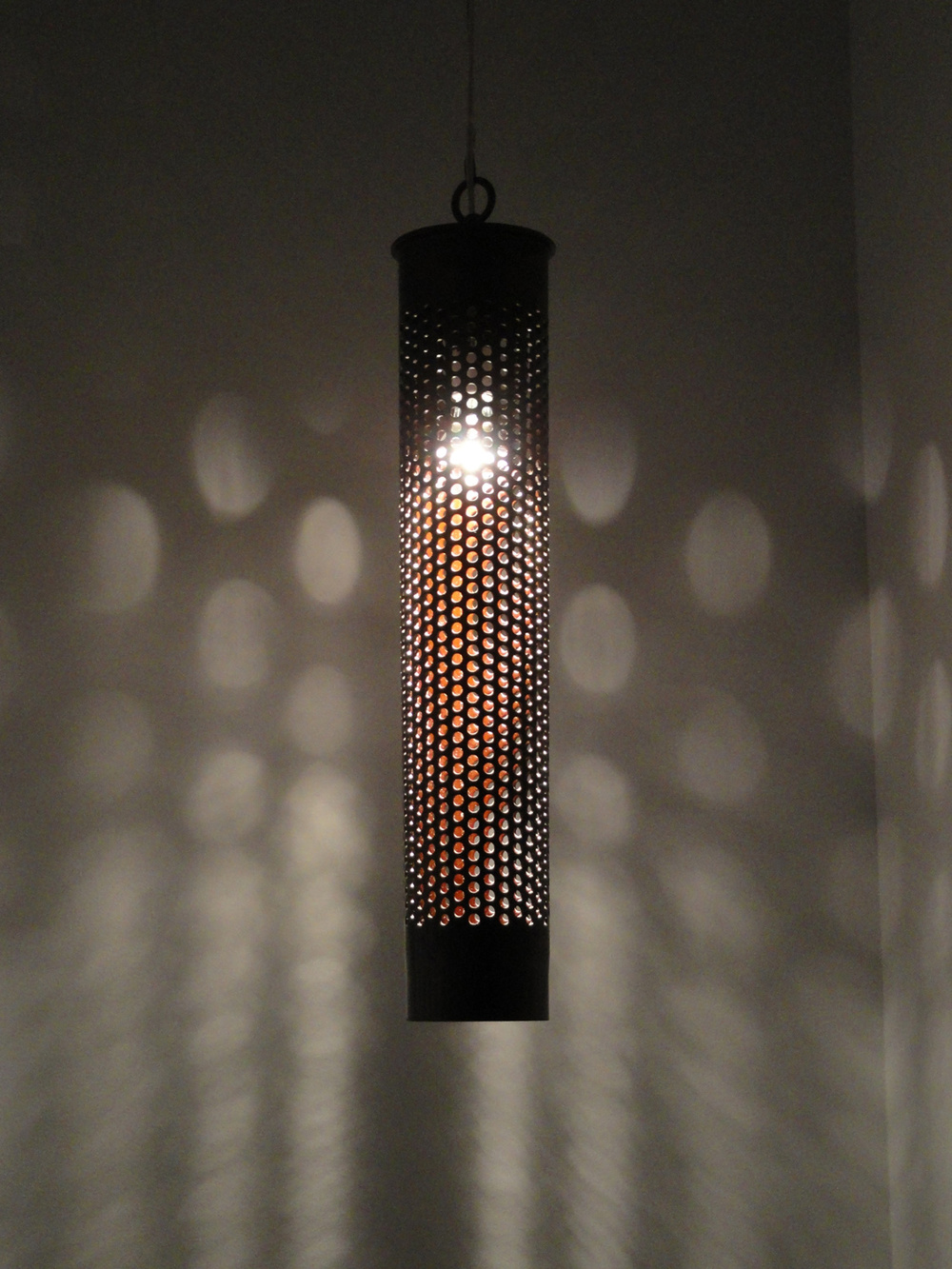 """Blamps"", my nick-name for these sleek, beautiful stairway pendant lamps I made from salvaged 106mm Howitzer shells."