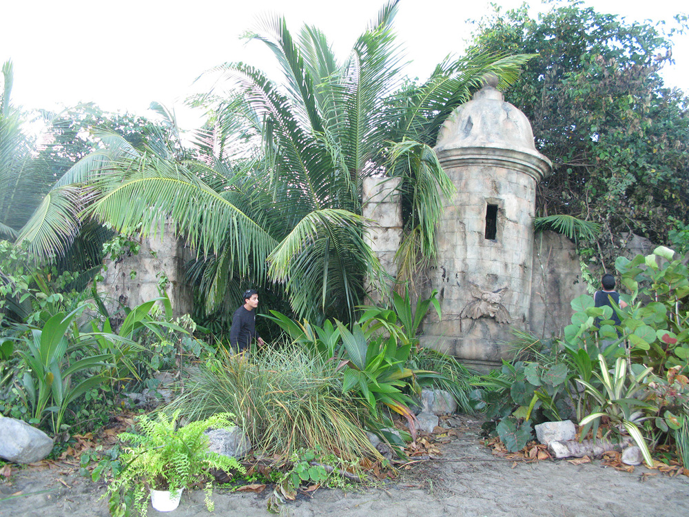 "A photo of the completed ruined ""Garita"" set on a beach on the edge of a dense jungle in Puerto Rico from ""The Wizards of Waverly Place: The Movie"" (2009)."