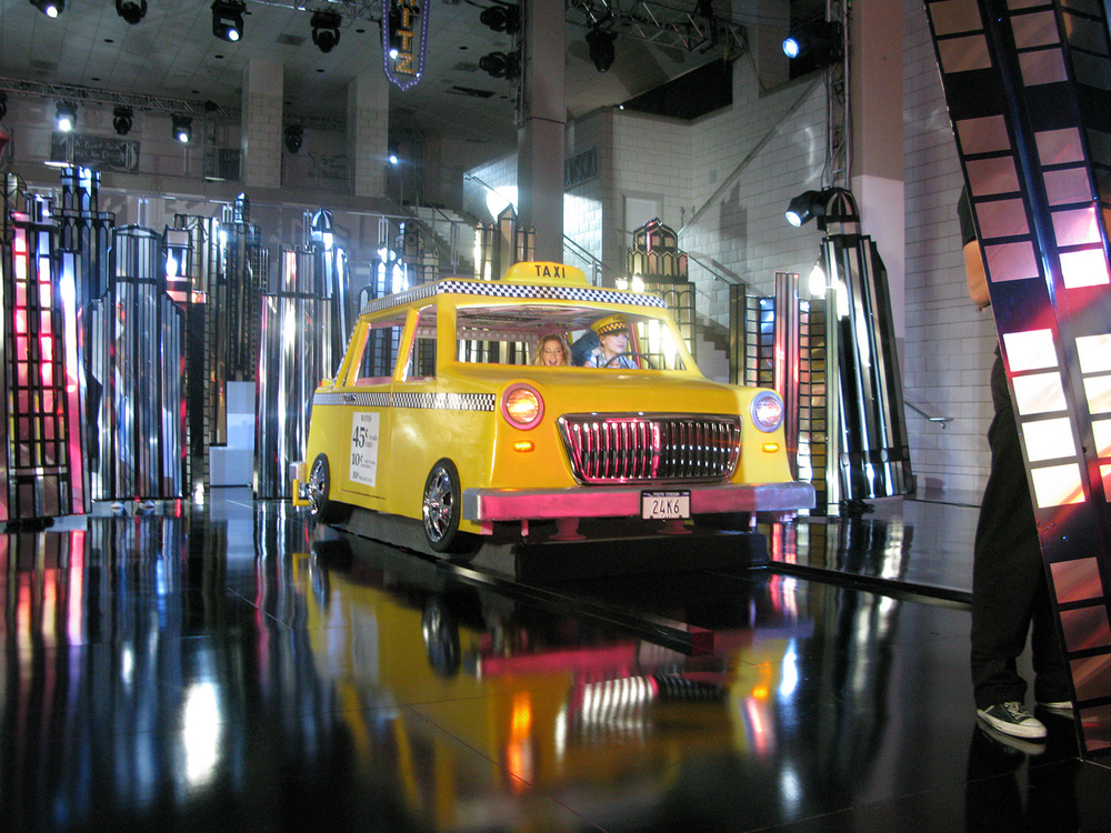"A photo of the ""Taxi/dressing room"" element for the ""I want it All"" musical number from ""High School Musical 3"" (2008). Here it's in it's ""Taxi"" configuration."