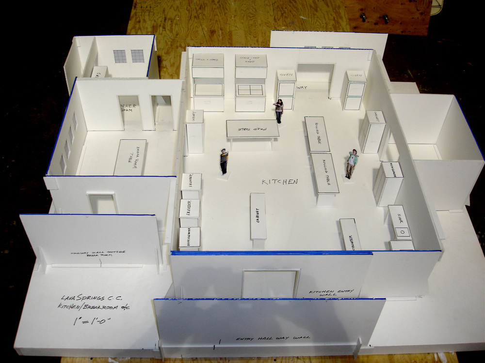Model of kitchen build and adjoining rooms. Designing for choreography requires extremely thorough planning for scale and placement of objects.