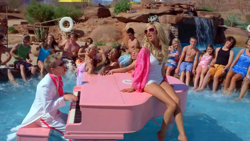"Musical twins Ryan (Lucas Grabeel) and Sharpay (Ashley Tisdale) perform ""Fabulous"" on the pool's pink grand piano."