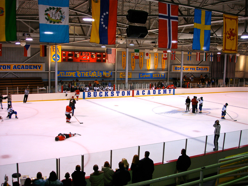 Part of the story centered around the idea of female hockey players becoming figure skaters and vis versa. Here we see a bland municipal hockey rink given some color and light.