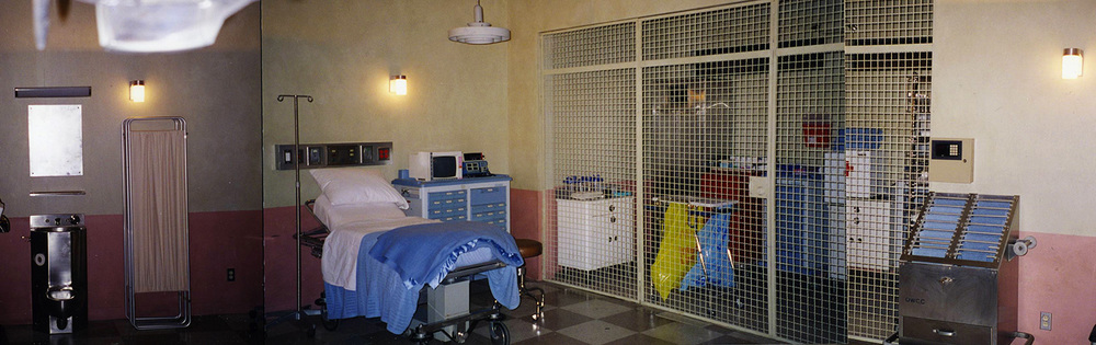 I was not the series production designer on Touched by an Angel, but they did need to shoot two overlap episodes one season to get caught up. Diane Millet, the regular series designer, brought me in for these extra episodes. Here is a women's prison infirmary stage set.