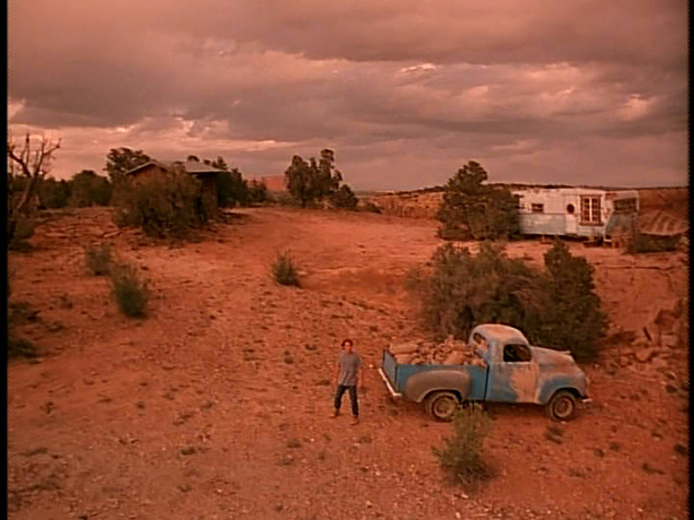 Wide shot of Wa Tho Huck's (Russell Means) desolate ranch on a red rock mesa in southern Utah.