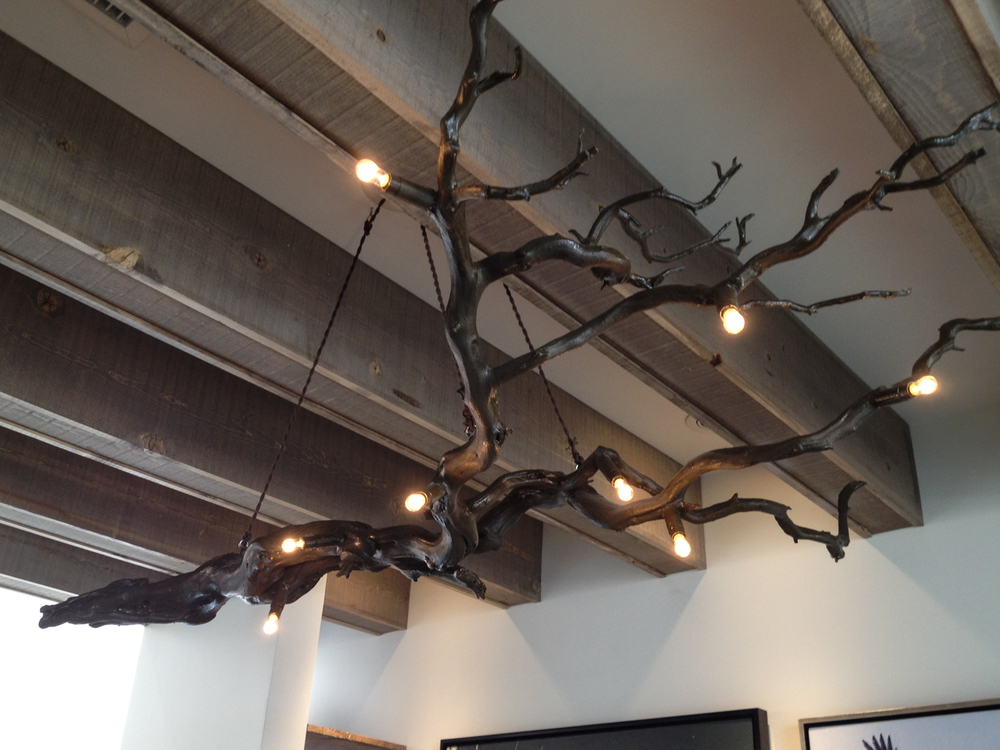 The clients wanted an art piece/light fixture over the desk that would be an interesting, natural counterpoint to the square cleanliness of the room. I routed out channels on the back and upper side of this beautiful branch, and completely concealed the wiring inside.