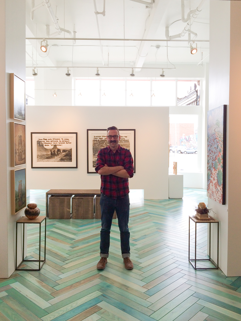 Yours Truly standing in the main gallery space.