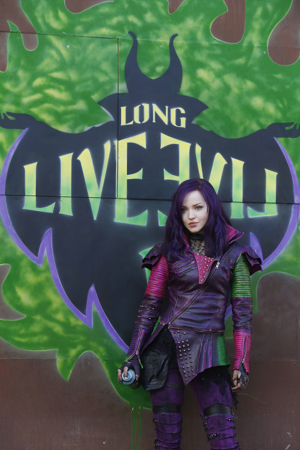 Dove Cameron as Mal in front of her Maleficent inspired street art on the Isle of the Lost.  (Disney Publicity photo)