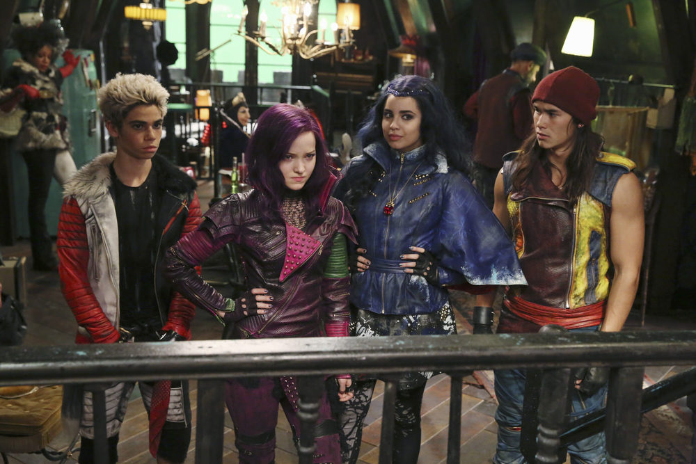 Carlos (Cameron Boyce), Mal (Dove Cameron), Evie (Sofia Carson) and Jay (Booboo Stewart) conspire in Maleficent's ratty apartment on the Isle of the Lost.  (Disney Publicity photo)