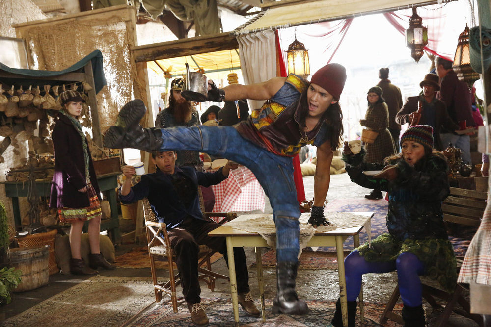 Jay (Booboo Stewart) shows off his acrobatic thieving skills in the crowded bazaar on the Isle of the Lost.  (Disney Publicity photo)