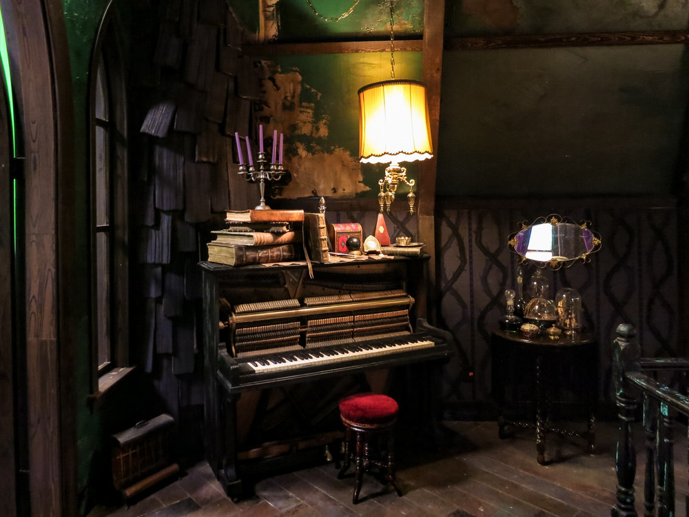 A detail of Maleficent's poorly tuned piano.