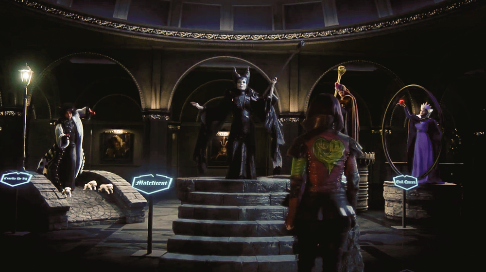 A screenshot of the finished VFX Gallery of the Villains set featuring the (about to spring to life) wax figure of Maleficent (Kristin Chenoweth) on her plinth in the Museum of Cultural History.