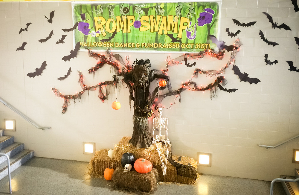 A display in the high school lobby for the social event of the year, the annual Romp the Swamp Halloween dance and fundraiser.