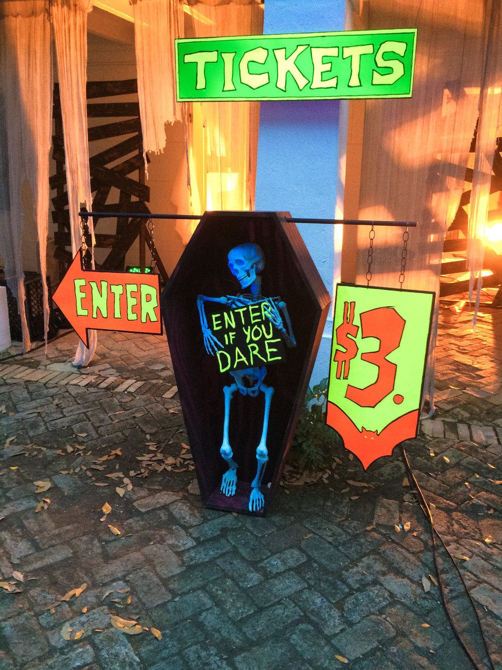 Nothing says creepy, period Halloween like blacklight effects. Here is our glowing ticket booth to enter the haunted plantation for Romp the Swamp.