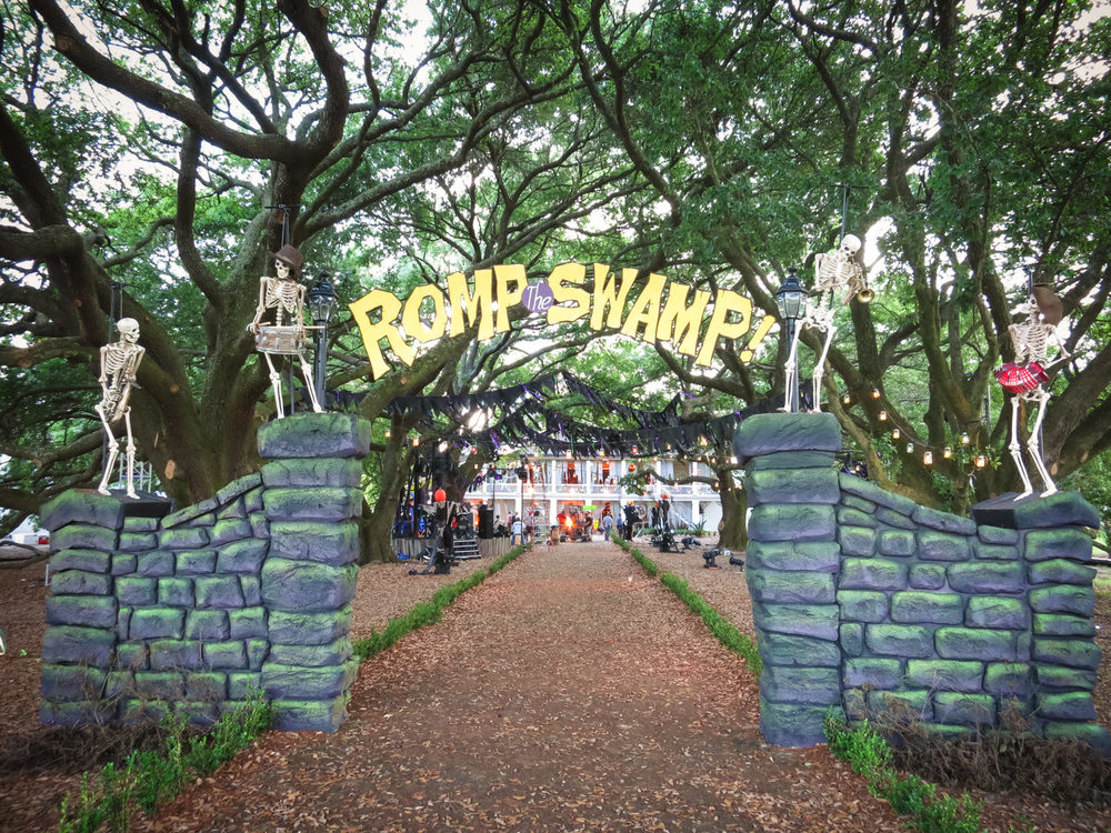 This is the entry gate to the Romp the Swamp Halloween dance. We built this at the far end of the Oak walk at the historic Whitney Plantation. The skeletons were hung by elastic from above so we could give them a little puppeted boogie with the music by pulling on them from below.
