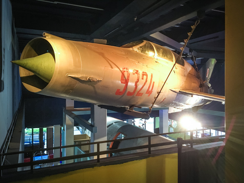 As floor space in the exhibit was limited, we found the only place we could put the Mig-21 was up. And so we did. It fit almost perfectly, with a bit of it's nose and a wing tip just peeking into the second floor galleries.