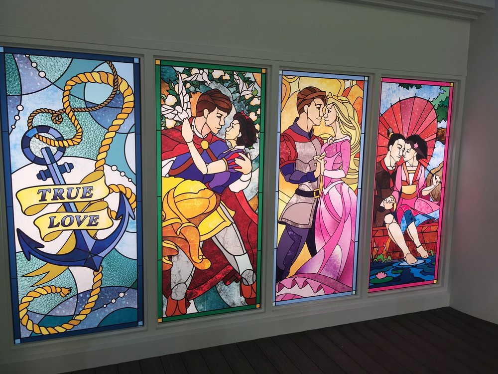 A detail of the stained glass windows on the yacht True Love, here celebrating Snow White, Sleeping Beauty and Mulan.