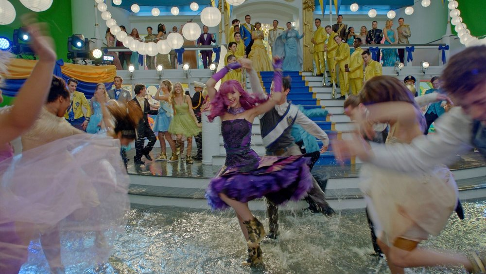 Mal (Dove Cameron) celebrates the evening on the flooded deck of the yacht True Love.