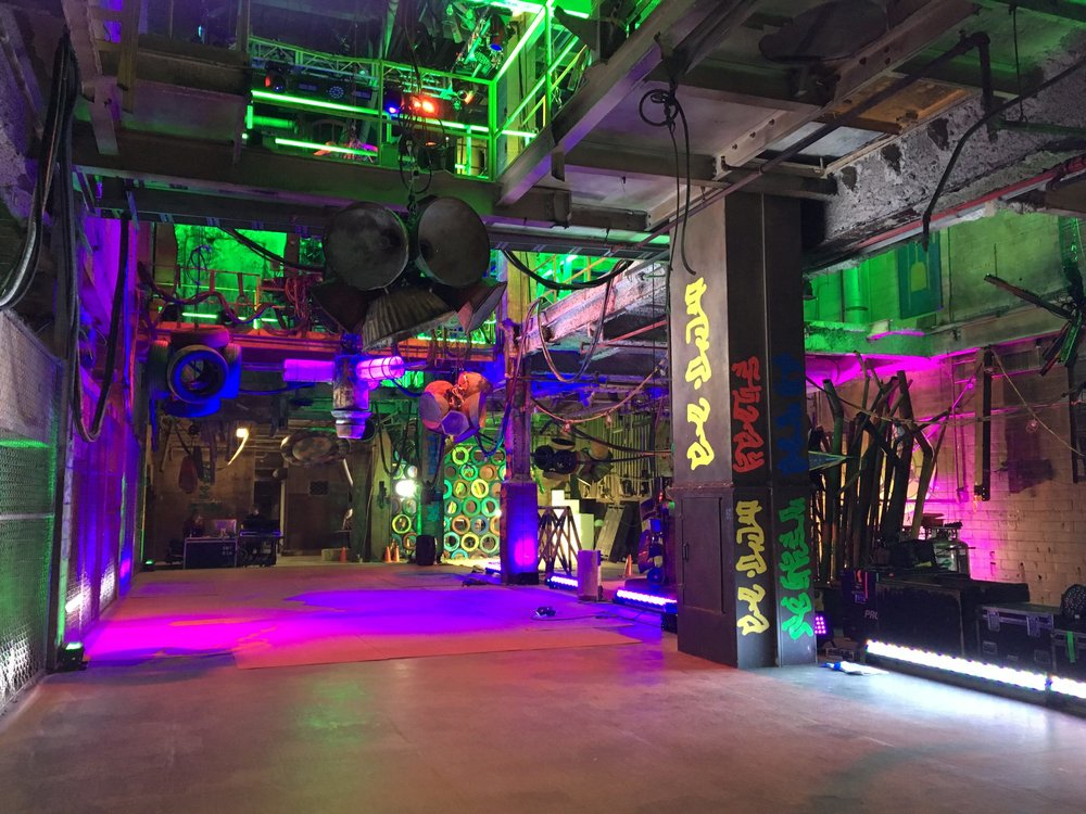 """Another view of the main hall of the ruined energy plant. Invisibly embedded in the center of the """"concrete"""" floor is a """"tricking"""" air mattress system that allowed the zombies to perform choreography that seemed to defy physics."""