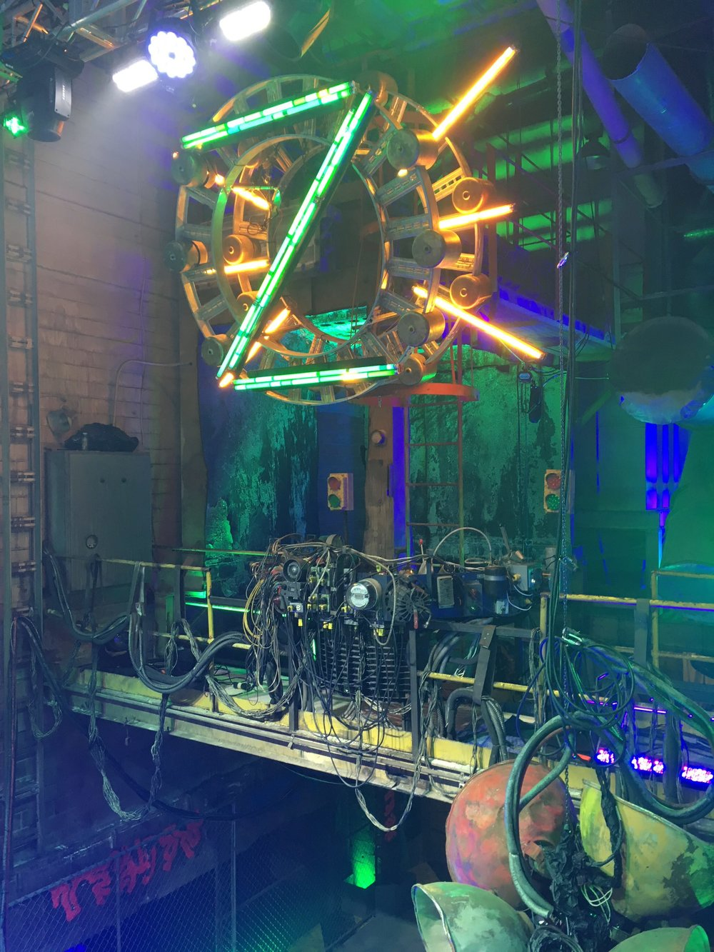 """The green zombie """"Z"""" hangs above Eliza's (Kylee Russell) light control booth on a catwalk over the dance floor."""