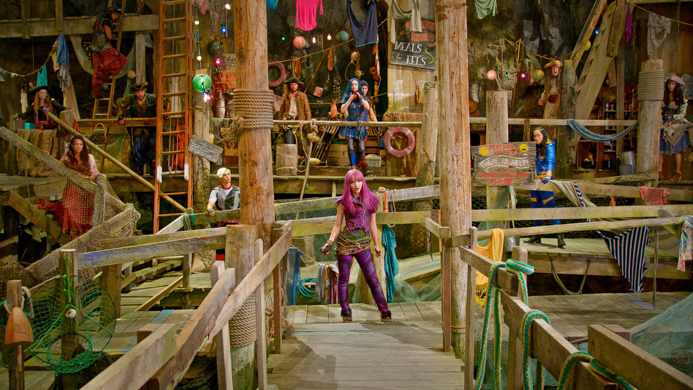 Mal (Dove Cameron) faces off across the gang plank from Uma's pirate gang.