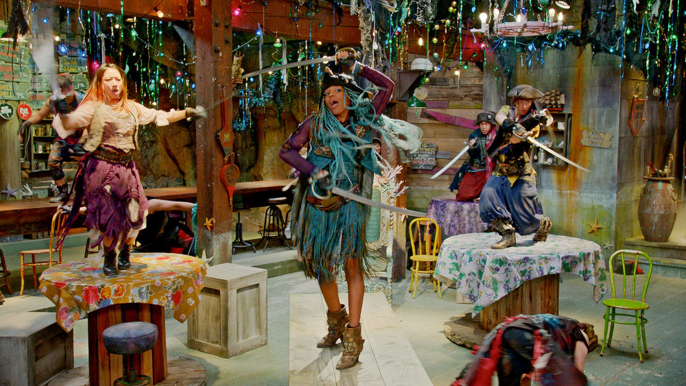 Here the ambitious and embittered Uma (China Anne McClain) rallies her pirate gang inside the Fish and Chips Shoppe, where her Sea Witch mother Ursula has pressed her into dreary service.