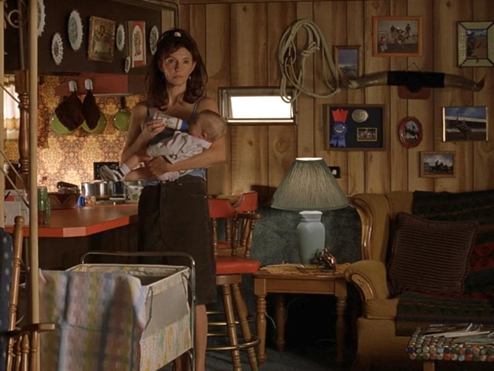 Estelle (Mary Steenburgen) in the kitchen/living room of Sonny's (Matthew Modine) trailer stage set.